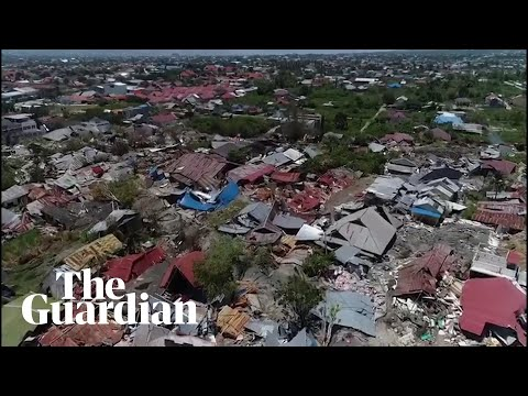 Indonesia tsunami: drone footage shows trail of destruction in Palu