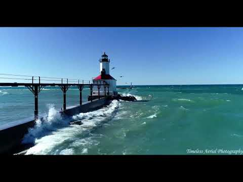Relaxing Waves Stunning Lake Michigan Lighthouse 4K Drone Video